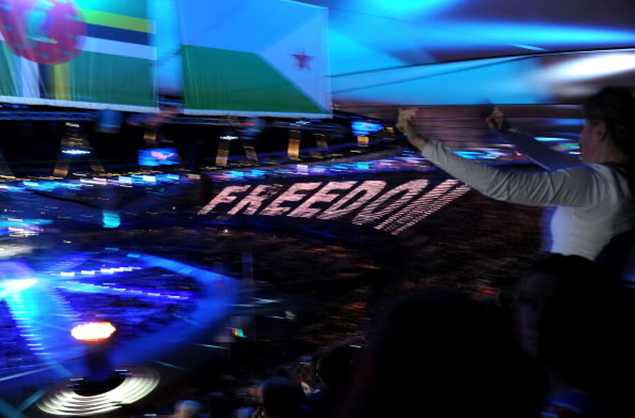 """Freedom"" is displayed across the stadium as George Michael performs during the Closing Ceremony. Photo: Getty Images"