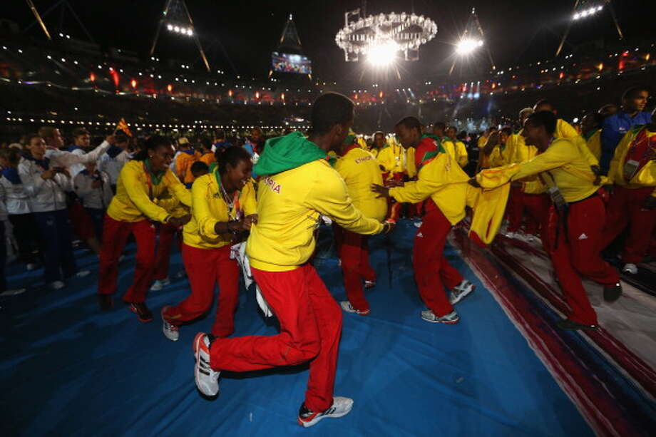 Athletes from Ethiopia soak up the atmosphere during the Closing Ceremony. Photo: Getty Images