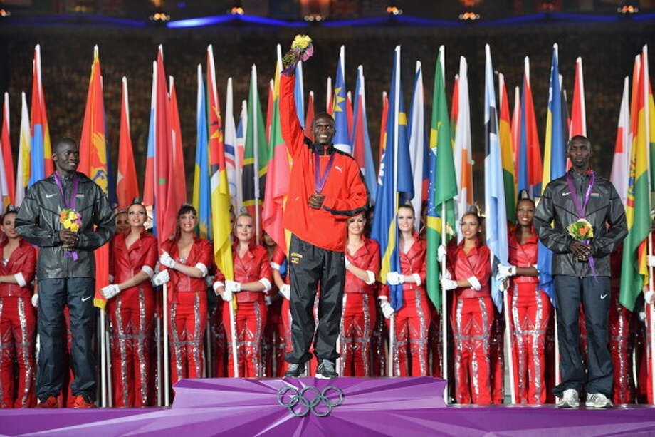 Silver medalist Abel Kirui of Kenya, gold medalist Stephen Kiprotich of Uganda and bronze medalist Wilson Kipsang Kiprotich of Kenya pose on the podium during the medal ceremony for the Men's Marathon during the Closing Ceremony. Photo: Getty Images