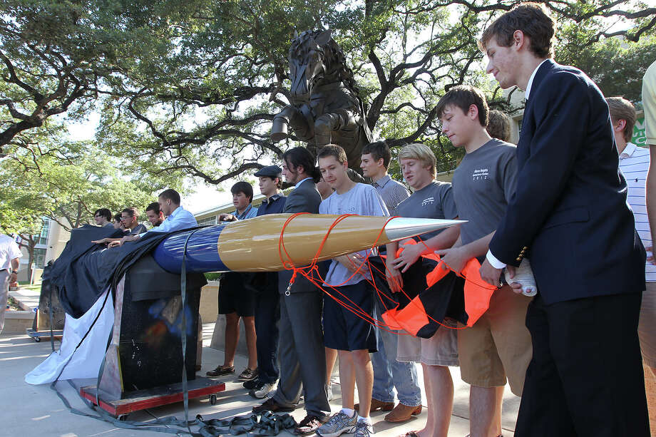 Alamo Heights students unveil a 22-feet tall rocket that they built and which will be launched at White Sands Missile Testing Range in New Mexico next week. On Thursday, August 2, 2012, the 22 students showed off the rocket to the public. The students all took part in building the rocket in their Aero-Science class headed up by teacher Colin Lang. Their goal is to send the rocket up 100,000 feet at a speed of Mach 3. Photo: Kin Man Hui, SAN ANTONIO EXPRESS-NEWS / ©2012 San Antonio Express-News
