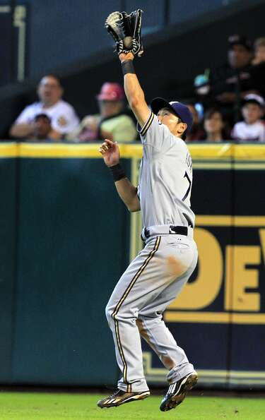 Brewers right fielder Norichika Aoki catches a flyball. (Cody Duty / Chronicle)