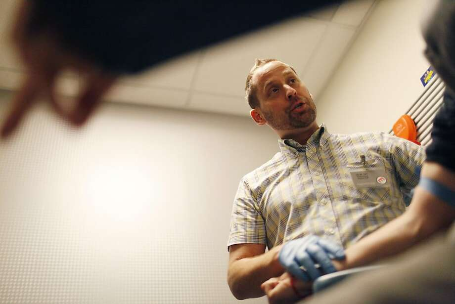Phlebotomist Jim Widmark draws a patient's blood to be tested for HIV at Magnet Health Center, which offers free health screening and counseling in San Francisco's Castro neighborhood. Photo: Alex Washburn