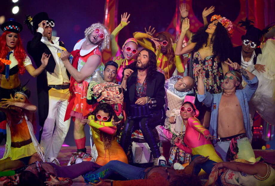 Russel Brand performs during the Closing Ceremony. Photo: Getty Images