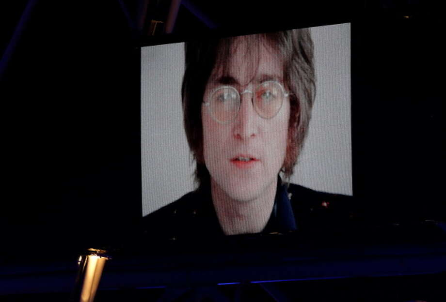 John Lennon is displayed on a screen inside the stadium during the Closing Ceremony. Photo: Getty Images