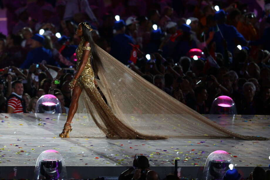 Naomi Campbell walks onstage during the Closing Ceremony. Photo: Getty Images