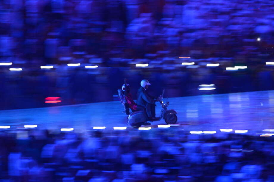 "Scooters enter the stadium as part of ""A Symphony of British Music"" during the Closing Ceremony. Photo: Getty Images"