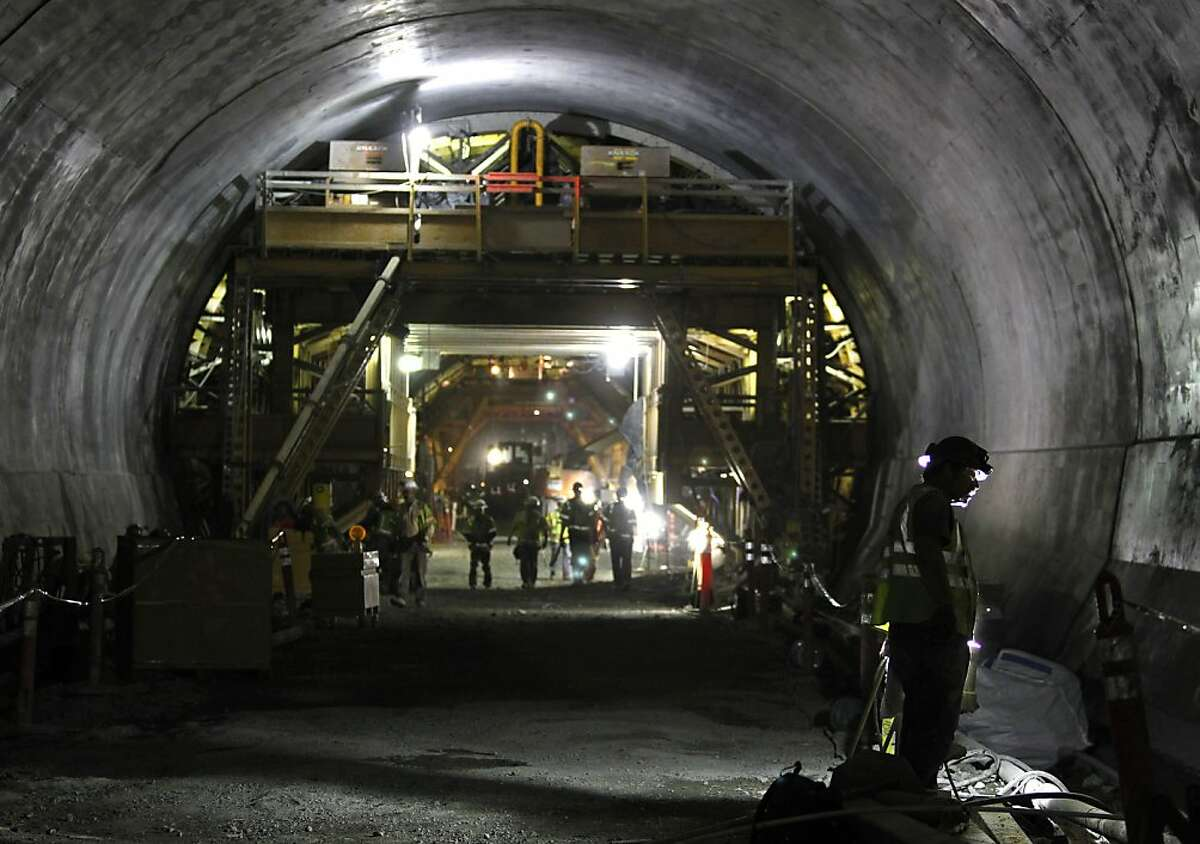 Construction crews work inside the fourth bore of the Caldecott Tunnel in Oakland, Calif. on Thursday, Aug. 9, 2012.