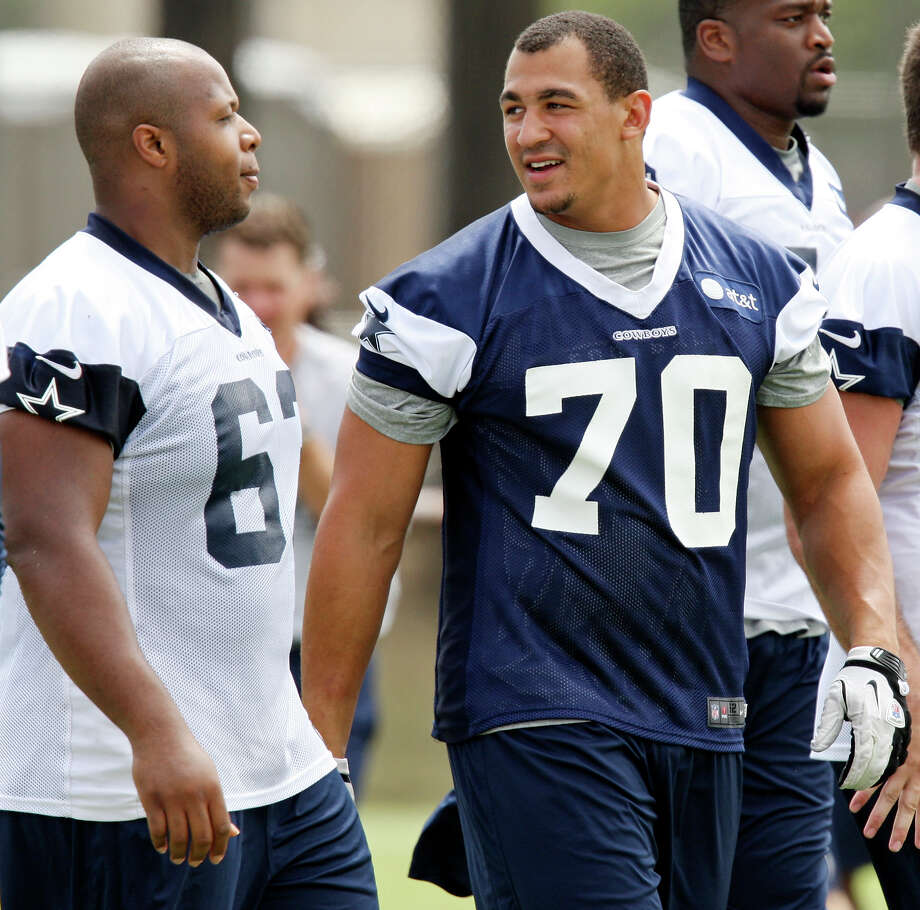 Dallas Cowboys guard Harland Gunn (left) talks with defensive tackle Tyrone Crawford during 2012 training camp held Tuesday July 31, 2012 in Oxnard, CA. Photo: Edward A. Ornelas, San Antonio Express-News / © 2012 San Antonio Express-News