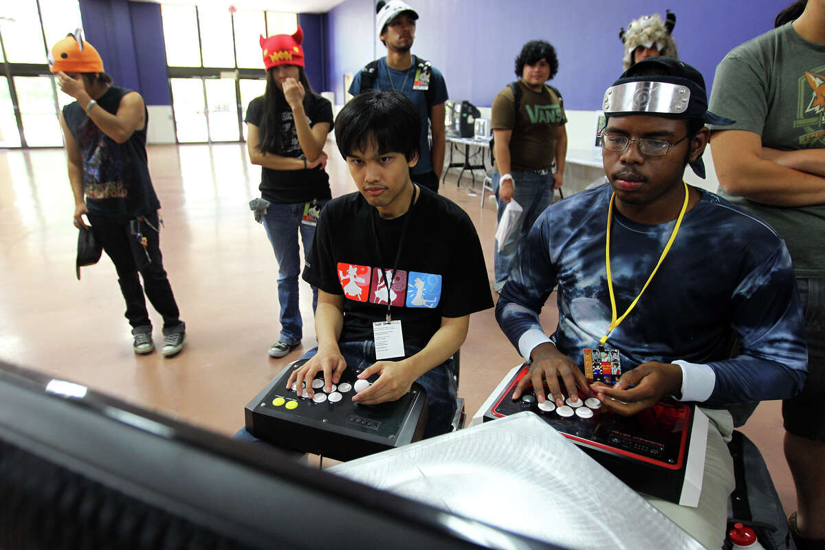 Wes Mojica, left, and Dominic Heningburg play the newly released P4A Persona 4 Arena game on a Play Station 3 during San Japan at the Henry B. Gonzalez Convention Center, Sunday, August 12, 2012. (JENNIFER WHITNEY)