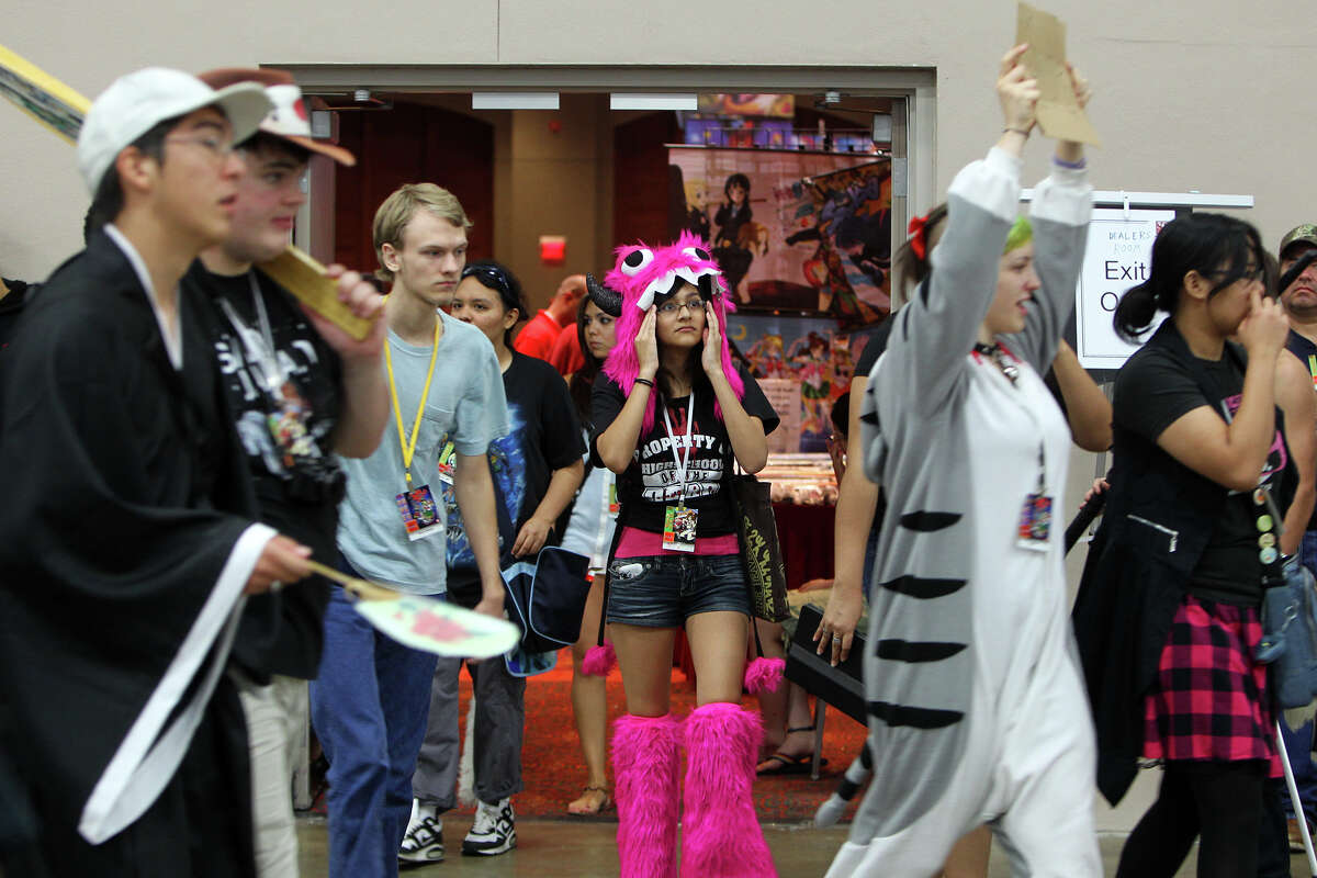 Attendees dressed in character move from room to room during the San Japan at the Henry B. Gonzalez Convention Center, Sunday, August 12, 2012. (JENNIFER WHITNEY)