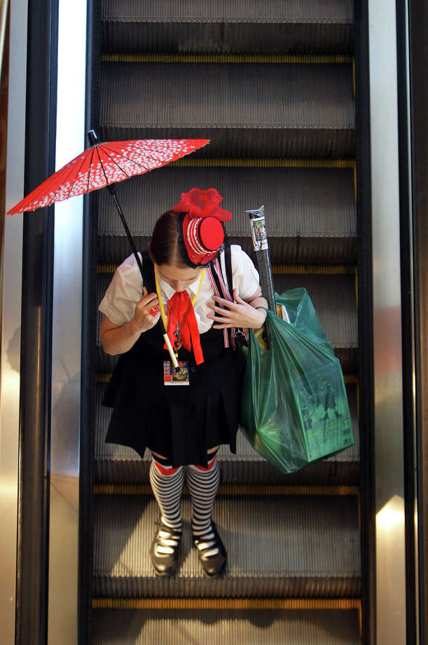 A woman dressed in character rides the escalator in the lobby of the Grand Hyatt during San Japan at the Henry B. Gonzalez Convention Center, Sunday, August 12, 2012. (JENNIFER WHITNEY) Photo: JENNIFER WHITNEY, Special To The Express-News / © Jennifer Whitney
