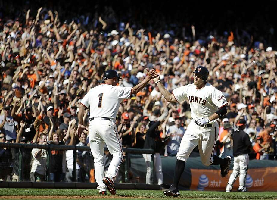 San Francisco Giants' Hunter Pence, right, is congratulated by third base coach Tim Flannery (1) after hitting a three-run home run off Colorado Rockies' Rafael Betancourt in the eighth inning of a baseball game, Sunday, Aug. 12, 2012, in San Francisco. (AP Photo/Ben Margot) Photo: Ben Margot, Associated Press