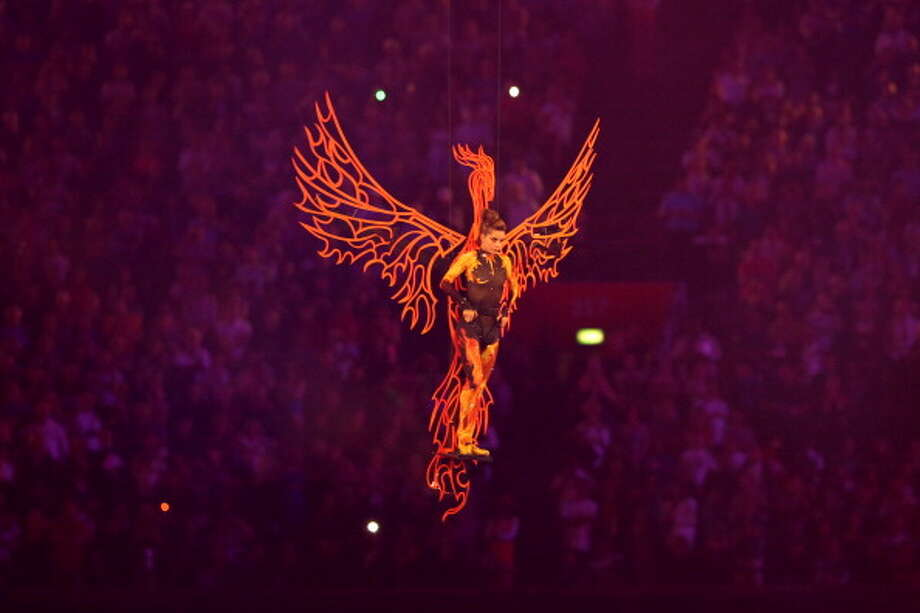 Ballerina Darcy Bussell is transported down from the roof of the stadium attached to a suspended phoenix during the Closing Ceremony. Photo: Getty Images