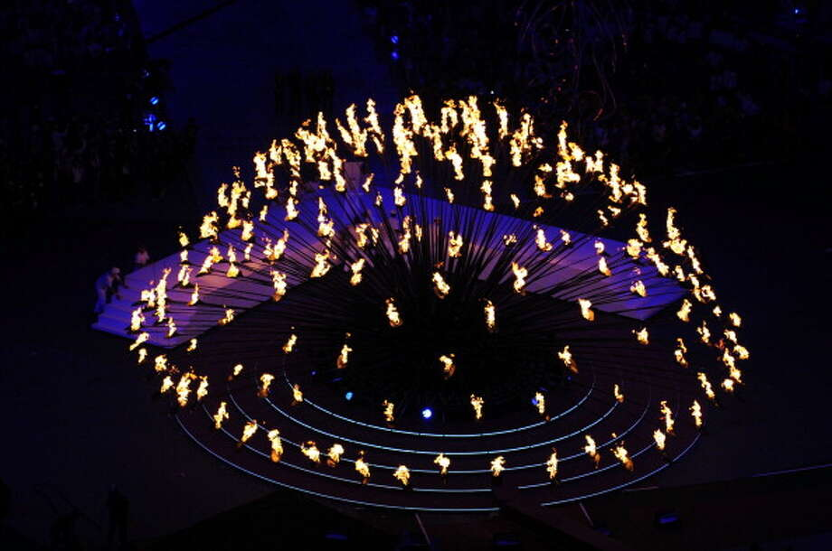 The Olympic cauldron is extinguished during the Closing Ceremony. Photo: Getty Images