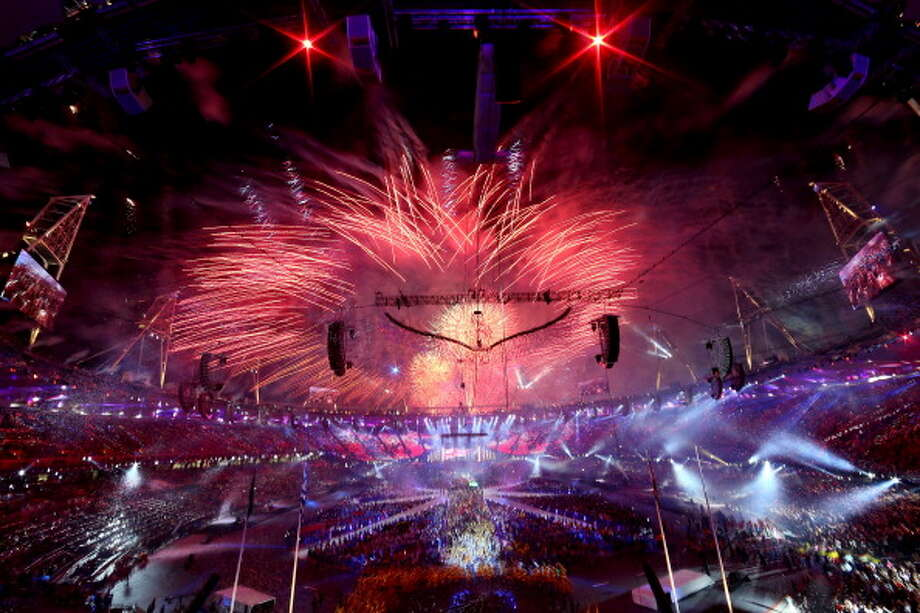Fireworks explode as the Olympic Cauldron is slowly lowered during the Closing Ceremony. Photo: Getty Images