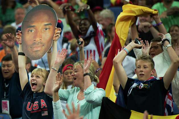 Fans cheer the USA on against Spain during the men's basketball gold medal match at the 2012 Summer Olympics on Sunday, Aug. 12, 2012, in London. Photo: Smiley N. Pool, Houston Chronicle / © 2012  Houston Chronicle