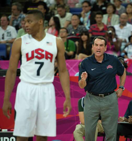 USA coach Mike Krzyzewski shouts directions to his team, including USA's Russell Westbrook during th