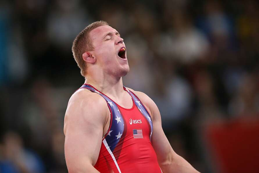 Jake Varner celebrates after defeating Ukraine's Valerii Andriitsev 1-0, 1-0 for the gold medal in t