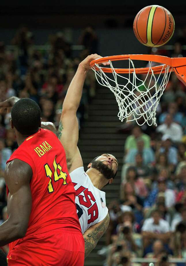 USA's Deron Williams misses on a dunk as Spain's Serge Ibaka defends during the men's basketball gold medal match at the 2012 Summer Olympics on Sunday, Aug. 12, 2012, in London. Photo: Smiley N. Pool, Houston Chronicle / © 2012  Houston Chronicle