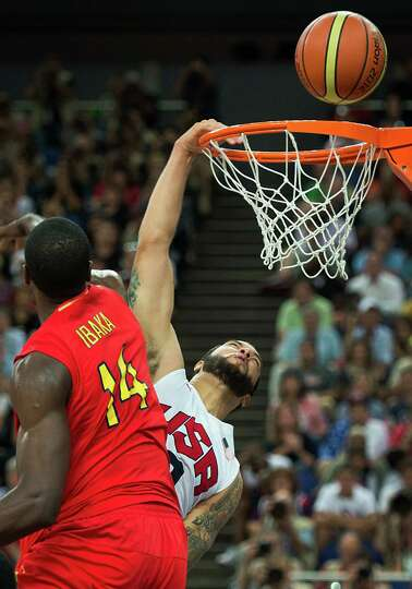 USA's Deron Williams misses on a dunk as Spain's Serge Ibaka defends during the men's basketball gol