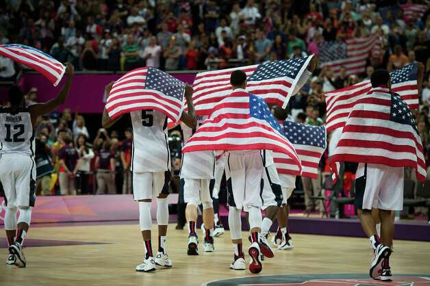 USA players walk off the court after a victory over Spain in the men's basketball gold medal match at the 2012 Summer Olympics on Sunday, Aug. 12, 2012, in London. Photo: Smiley N. Pool, Houston Chronicle / © 2012  Houston Chronicle