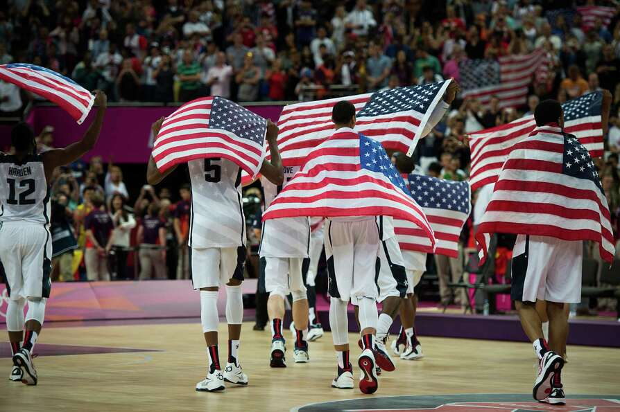 USA players walk off the court after a victory over Spain in the men's basketball gold medal match a