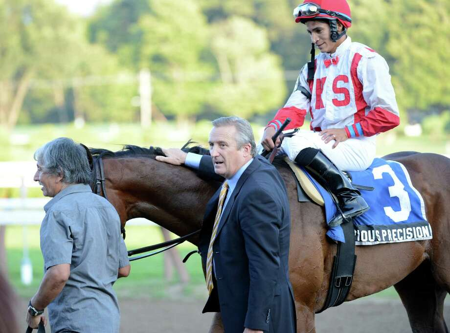 Spurious Precision with jockey Alan Garcia is met on the way to the winner's circle by trainer Rick Violette, center after  winning the 107th running of The Saratoga Special at the Saratoga Race Course  in Saratoga Springs, N.Y. Aug 12, 2012.      (Skip Dickstein/Times Union) Photo: Skip Dickstein