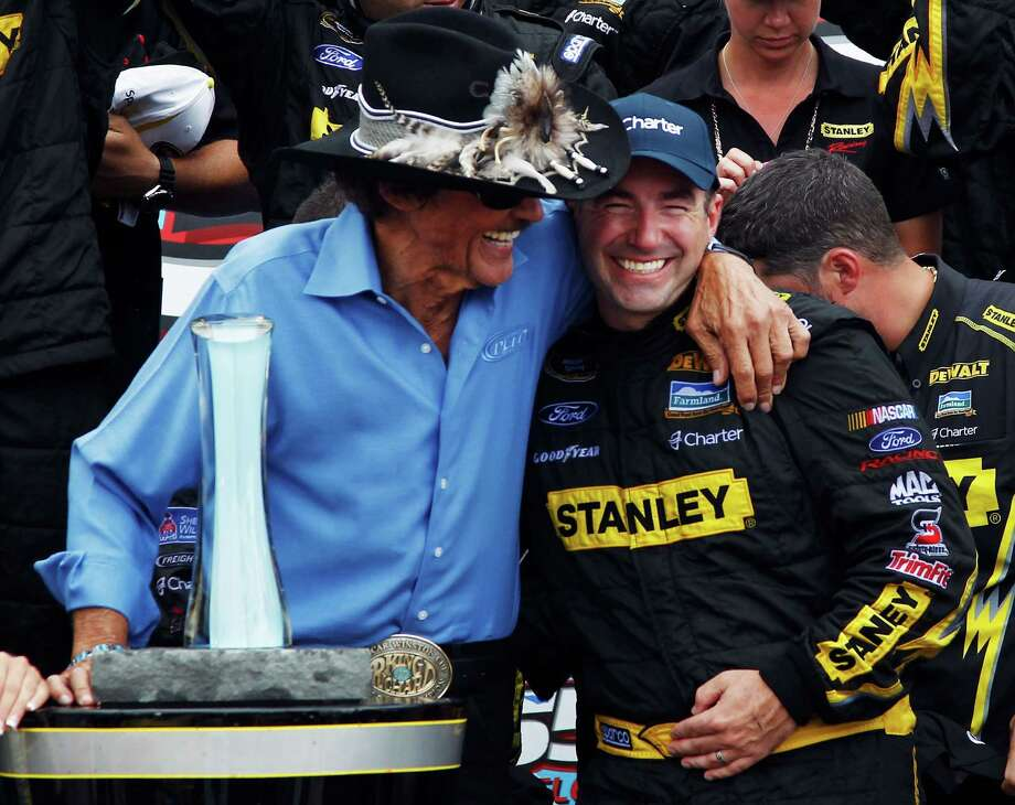 Marcos Ambrose, right, gets a celebratory hug from team owner Richard Petty in Victory Lane. Photo: Jeff Zelevansky / 2012 Getty Images