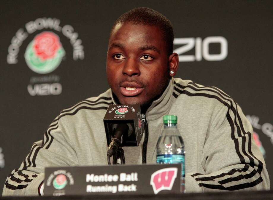 FILE - In this Dec. 28, 2011, file photo, Wisconsin running back Montee Ball speaks at a news conference in Los Angeles for the Rose Bowl NCAA college football game. Five men attacked the star running back near campus early Wednesday morning, Aug.1 , 2012,  inflicting head injuries serious enough to send him to the hospital, authorities said. Ball, a Heisman Trophy finalist last season as a junior, was taken to a hospital with head injuries, police said. (AP Photo/Jason Redmond, File) Photo: Jason Redmond, Associated Press / FR74394 AP