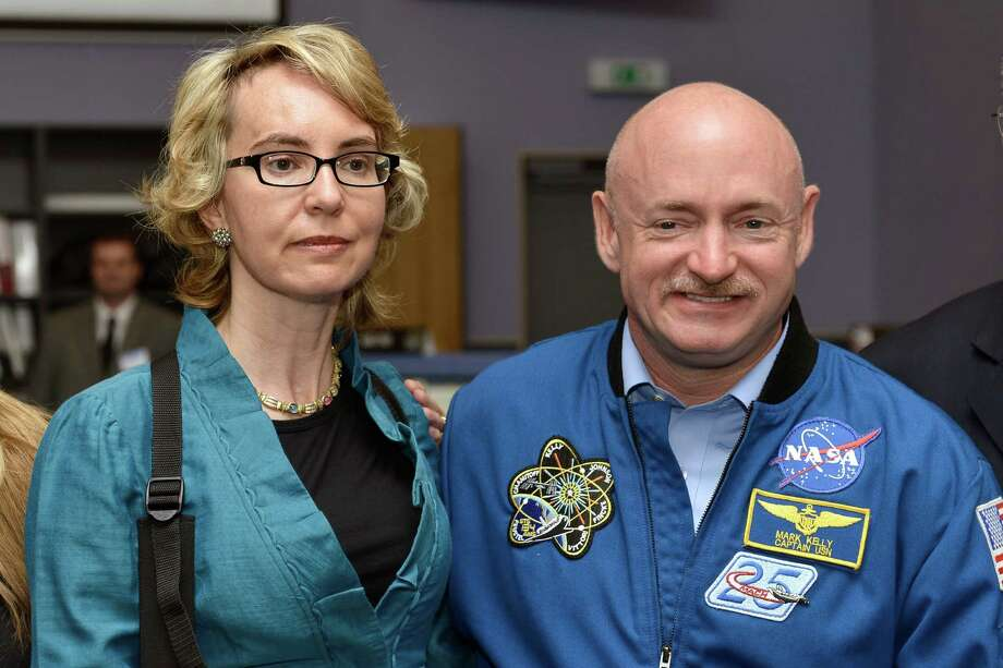 Former U.S. Rep. Gabrielle Giffords and husband Mark Kelly, a former astronaut, visit the Alpha Magnetic Spectrometer Payload Operations and Command Center at the European Organization for Nuclear Research near Geneva on July 25. They lived in Houston while she underwent intensive physical and speech therapy. Photo: Martial Trezzini / KEYSTONE