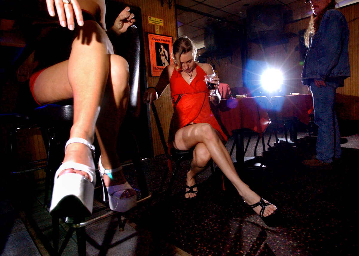 Dancers Tori, left, and Michaela, center, relax before they entertain the lunch crowd at Nite Moves on Wednesday, May 7, 2003, in Latham. (Times Union archive)