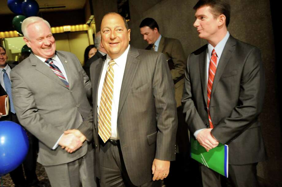 Sen. Martin Golden, left, greets Sen. Thomas Libous, center, as he waits speak during New York AFSCME?s annual Albany Lobby Day on Tuesday, March 6, 2012, at the Convention Center in Albany, N.Y. At right is Brian McDonnell of AFSCME. (Cindy Schultz / Times Union) Photo: Cindy Schultz / 00016694A