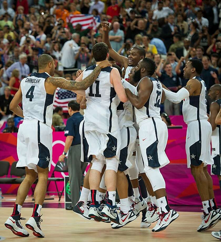 Members of the U.S. men's basketball team celebrate after their 107-100 victory over Spain in the gold medal game. Photo: Smiley N. Pool, Hearst Newspapers