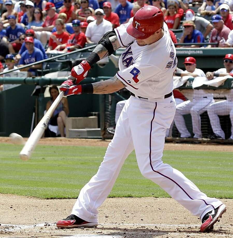 Josh Hamilton, right, hit his 32nd homer and drove in three runs. Photo: LM Otero, Associated Press