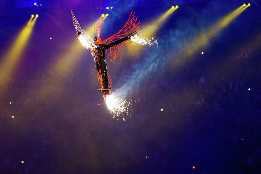 A performer flies over the stadium during the closing ceremony.