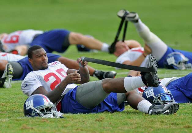 New York Giants running back D.J. Ware stretches near the end of a training camp practice at UAlbany on Sunday Aug. 12, 2012 in Albany, NY.  (Philip Kamrass / Times Union) Photo: Philip Kamrass / 00018767B