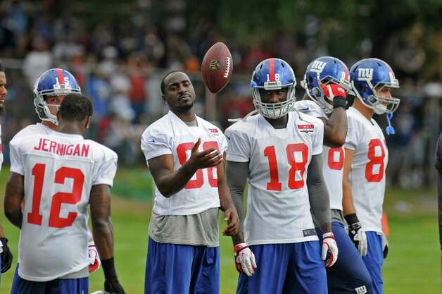 Injured New York Giants wide receiver Hakeem Nicks juggles a ball on the sidelines during a training camp practice at UAlbany on Sunday Aug. 12, 2012 in Albany, NY.  (Philip Kamrass / Times Union) Photo: Philip Kamrass / 00018767B