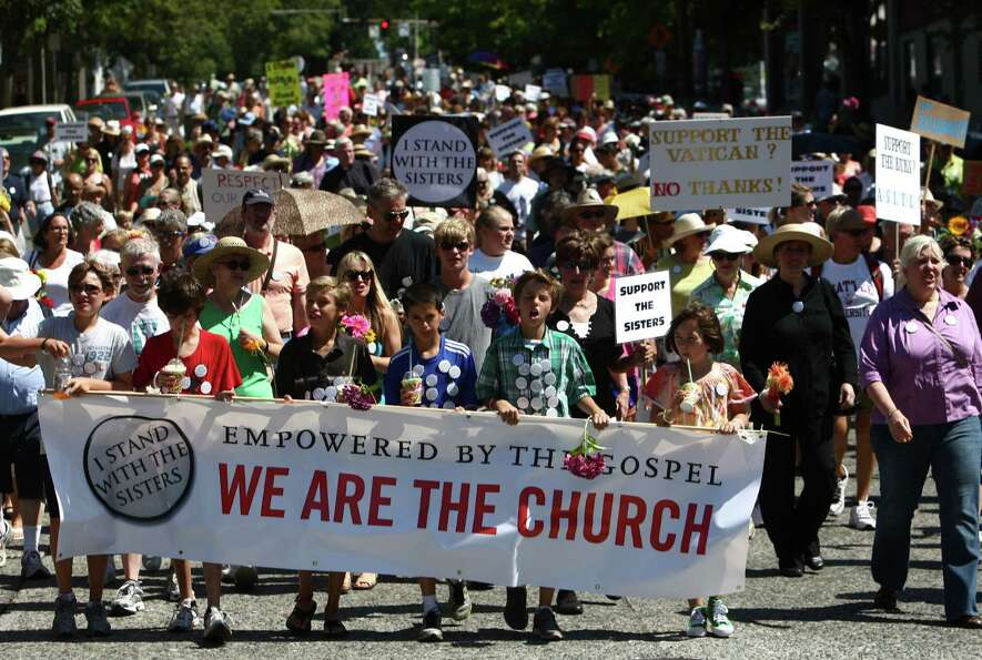 People march through Capitol Hill and First Hill to Saint James Cathedral in Seattle on Sunday.