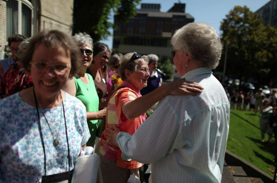 Catholic nuns gather on the steps of Saint James Cathedral in Seattle as people came out to support Catholic nuns on the steps of Saint James Cathedral, the episcopal seat of Archbishop Peter J. Sartain, the Roman Catholic bishop tasked by the Vatican to oversee nuns in the U.S. Photo: JOSHUA TRUJILLO / SEATTLEPI.COM