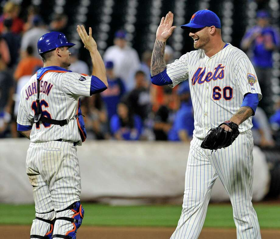 New York Mets pitcher Jon Rauch (60) celebrates with catcher Rob Johnson after the Mets defeated the Atlanta Braves, 6-5, in a baseball game Sunday, Aug. 12, 2012, at Citi Field in New York. (AP Photo/Bill Kostroun) Photo: Bill Kostroun
