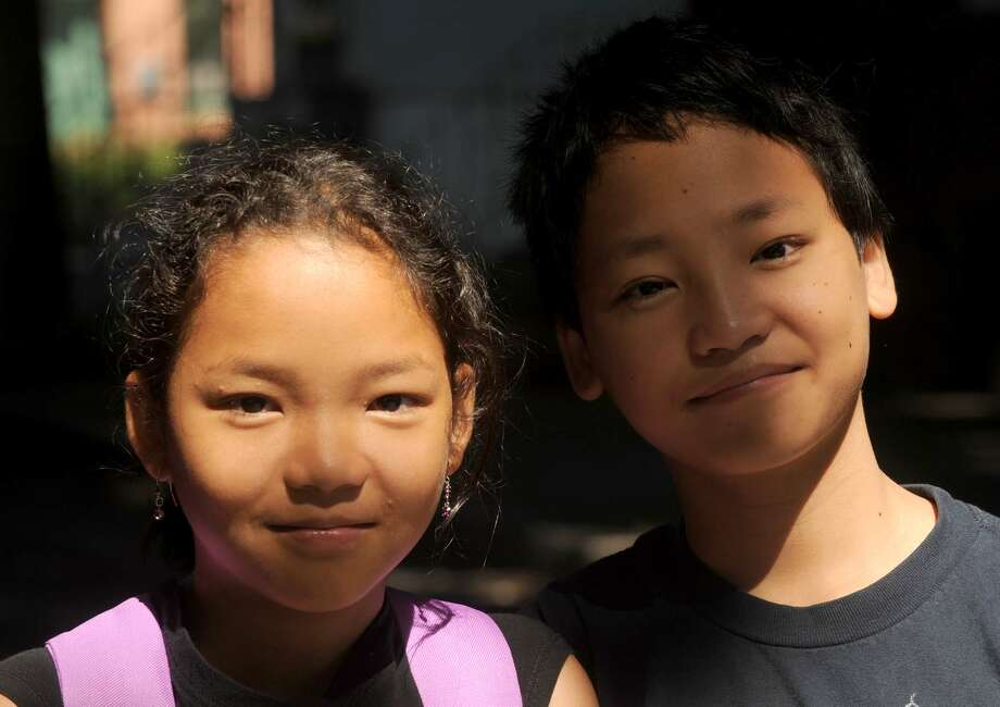 Ten-year-old Eh Thaw Soe, left, and her 12-year-old brother Ken Blu Soe in Albany NY Saturday July 21, 2012. (Michael P. Farrell/Times Union) Photo: Michael P. Farrell