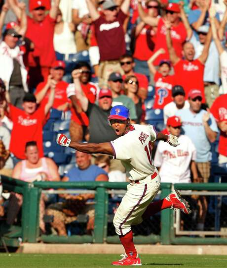 Juan Pierre leads the cheers after his infield single in the 11th inning scored Jimmy Rollins to give the Phillies an 8-7 walk-off victory over the Cardinals. Photo: Ron Cortes / Philadelphia Inquirer