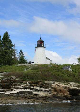 Built in 1821, Burnt Island Lighthouse still signals safe passage to mariners entering Boothbay Harbor during foul weather. Photo: Kathleen Scott / For The Express-News, Kathleen Scott / For The Express