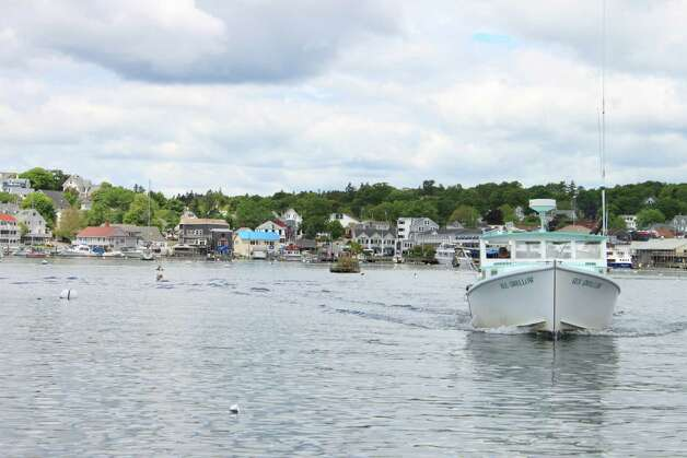 Homes and businesses ring the waterfront of Maine's midcoast villages.  Boothbay Harbor hosts schooners, whale-watching boats, cruise liners, pleasure boats and a cadre of  lobstermen tending traps. Photo: Kathleen Scott / For The Express-News, Kathleen Scott / For The Express