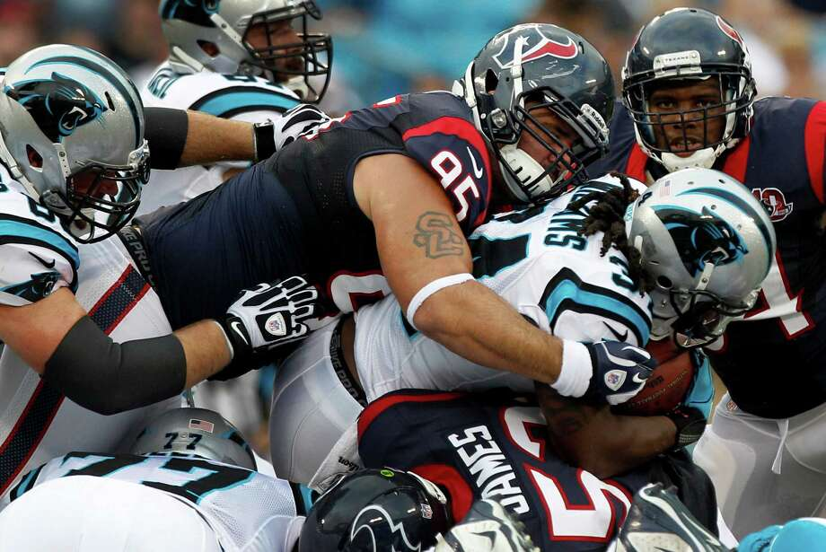 Texans nose tackle Shaun Cody (95) won't be seeing any action right away after injuring his back during Saturday's 26-13 preseason win over the Panthers. Photo: Brett Coomer / © 2012  Houston Chronicle