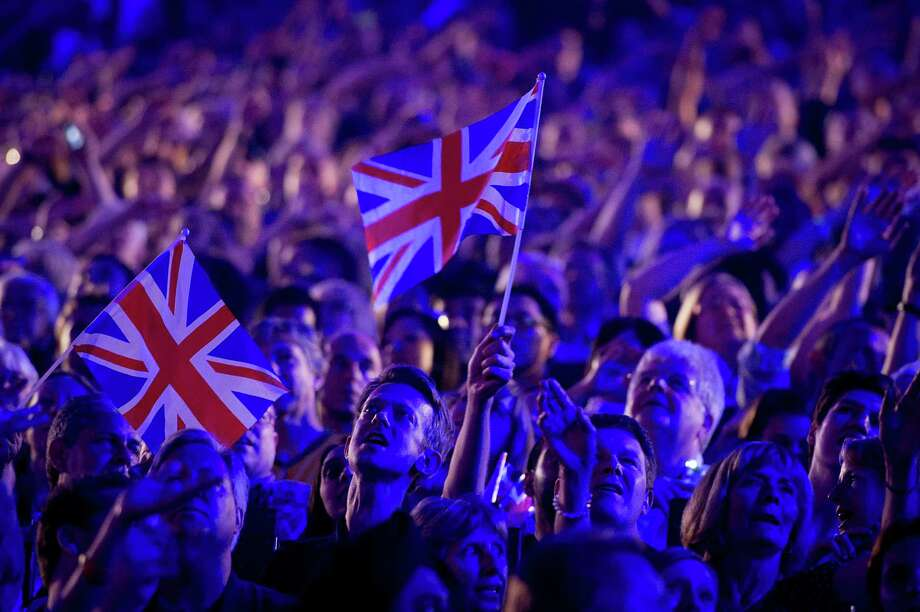 """As the curtain fell on the London Games, many of the 80,000 in attendance for Sunday's Closing Ceremony at Olympic Stadium sang along as Liam Gallagher performed """"Wonderwall,"""" a 1990s hit by his former band, Oasis. Photo: Smiley N. Pool / © 2012  Houston Chronicle"""