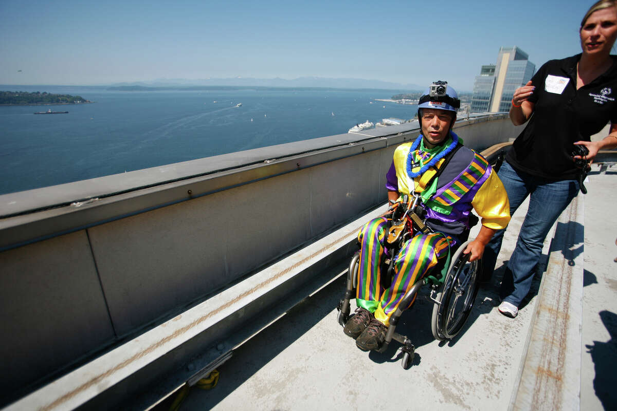 Dale Doornek, a paraplegic from Sultan, Washington, prepares to rappels off of Seattle's 1000 2nd Avenue Building during the Special Olympics Over The Edge event on Sunday, Aug. 12, 2012. Participants of the Over the Edge event fundraised money for the Special Olympics while rappelling 40 stories off of a building. (Photo by Sofia Jaramillo)