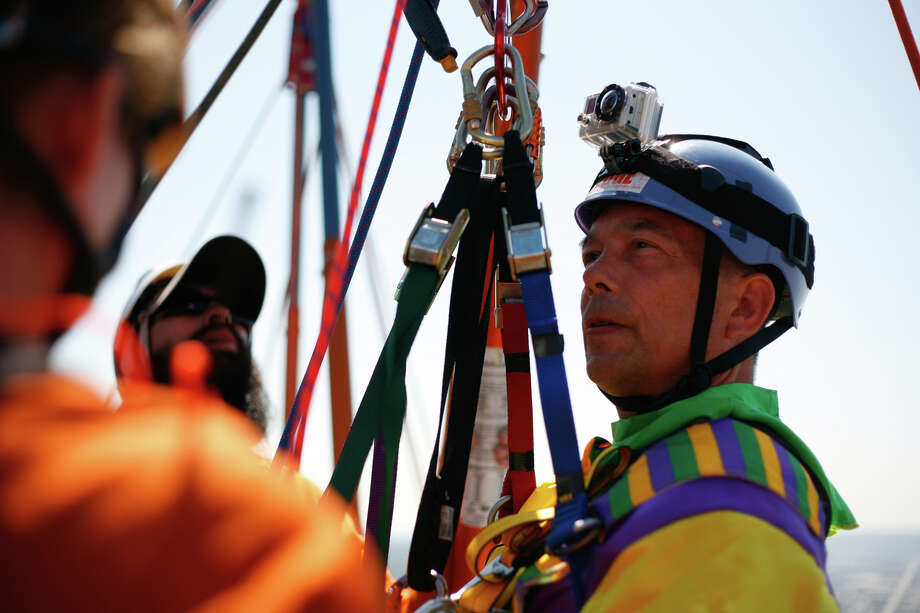 Dale Doornek, a paraplegic from Sultan,  Washington, takes a deep breath before he rappels off of Seattle's 1000 2nd Avenue Building during the Special Olympics Over The Edge event on Sunday, Aug. 12, 2012. Participants of the Over the Edge event fundraised money for the Special Olympics while rappelling 40 stories off of a building. (Photo by Sofia Jaramillo) Photo: Sofia Jaramillo, Seattlepi.com Photos / SEATTLEPI.COM
