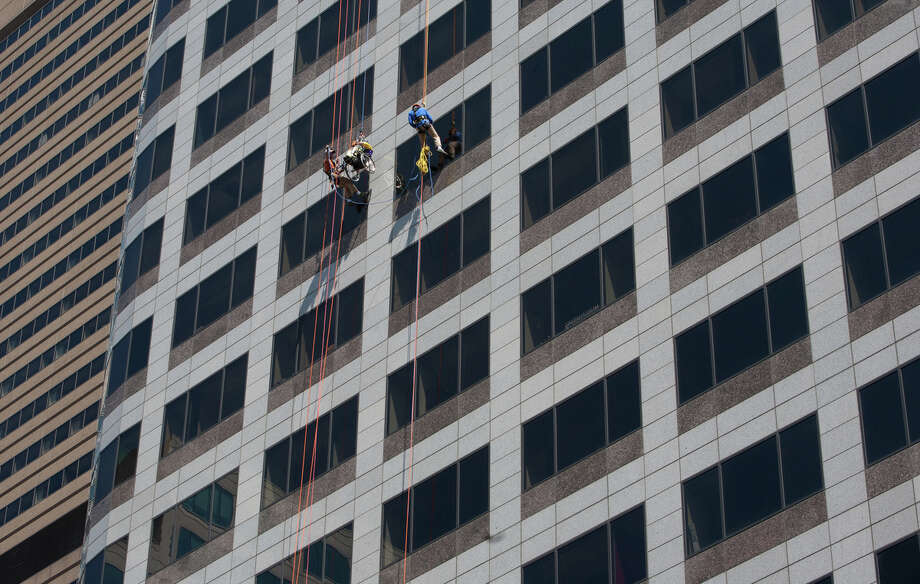 Dale Doornek, a paraplegic from Sultan, Washington, and a professional rappel off of Seattle's 1000 2nd Avenue Building during the Special Olympics Over The Edge event on Sunday, Aug. 12, 2012. Participants of the Over the Edge event fundraised money for the Special Olympics while rappelling 40 stories off of a building. (Photo by Sofia Jaramillo) Photo: Sofia Jaramillo, Seattlepi.com Photos / SEATTLEPI.COM