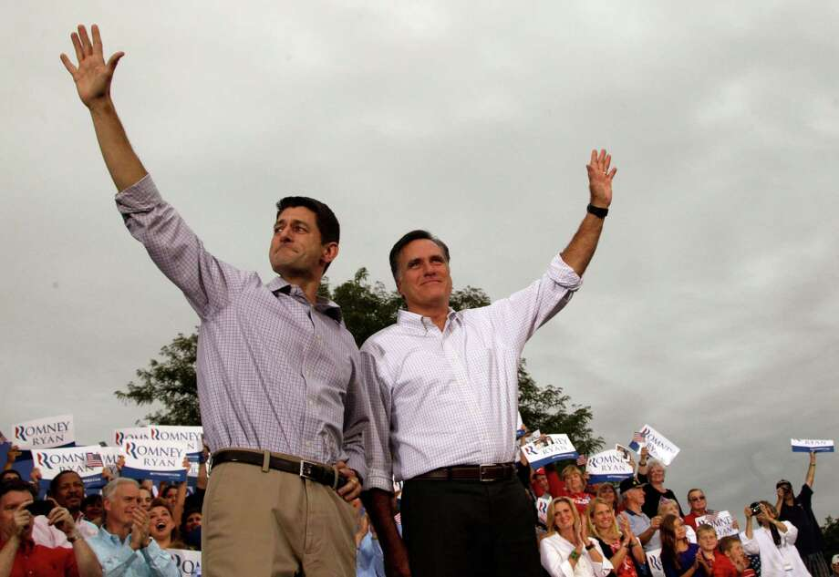 Republican presidential candidate, former Massachusetts Gov. Mitt Romney, right, and vice presidential running mate Rep. Paul Ryan of Wisconsin, greet the crowd during a campaign event at the Waukesha County Expo Center, Sunday, Aug. 12, 2012, in Waukesha, Wis. (AP Photo/Mary Altaffer) Photo: Mary Altaffer